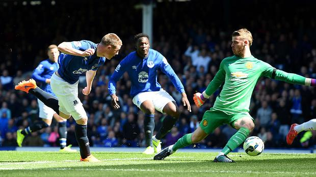 James McCarthy, left, scores Everton's first goal against Manchester United