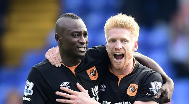Boss Steve Bruce hopes Dame N'Doye, left, can fire the goals to keep Hull City in the Premier League