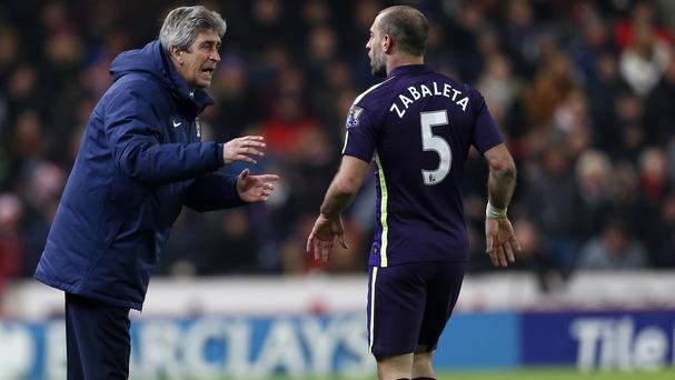 Pablo Zabaleta, right, does not think it is fair to blame manager Manuel Pellegrini for all Manchester City's failings
