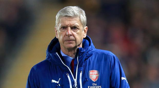 Arsene Wenger saw Arsenal continue their winning run against Hull