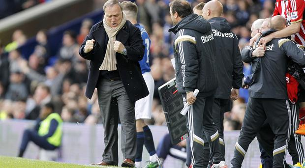 Dick Advocaat, left, celebrates a vital victory for Sunderland