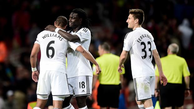 Bafetimbi Gomis, centre, scored the only goal of the game as Swansea completed the double over Arsenal