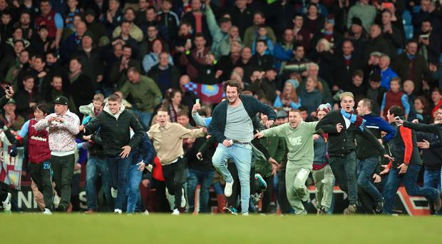 Aston Villa have been handed a hefty fine following a pitch invasion by supporters