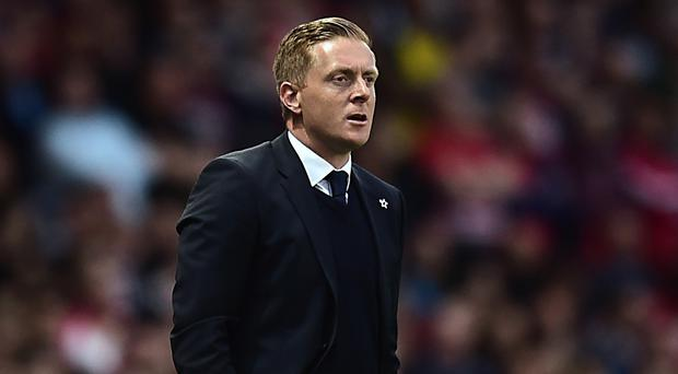 Swansea manager Garry Monk, pictured, will sign his new contract offer 'very quickly', according to club chairman Huw Jenkins