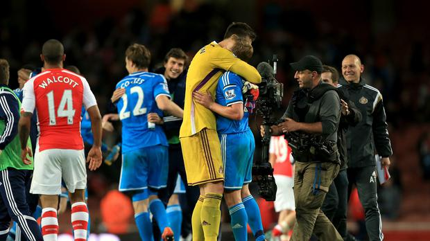 Sunderland players celebrate after securing Premier League safety