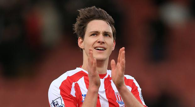 Stoke have exercised their right to buy Philipp Wollscheid after a successful loan