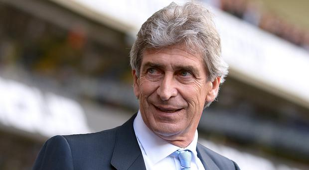 Manchester City manager Manuel Pellegrini is confident he will still be in position next season