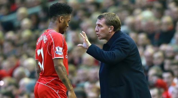 Liverpool manager Brendan Rodgers, pictured right, hopes for a more private future when it comes to Raheem Sterling's contract discussions