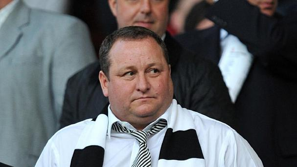 Mike Ashley says he will not sell Newcastle until they win a trophy or finish in the top four of the Champions League