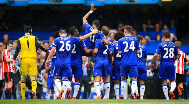 Didier Drogba, fourth from left, was carried off by his team-mates in Chelsea's win