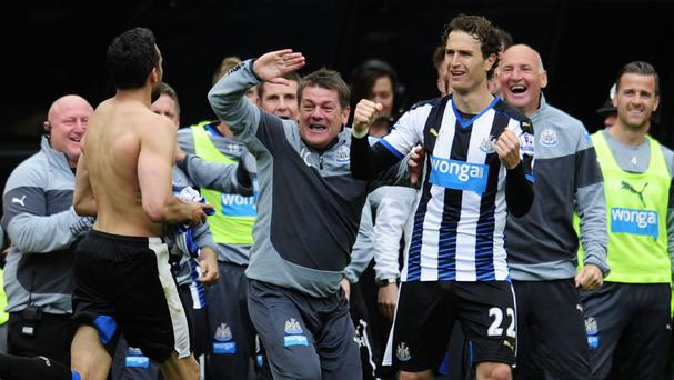 Jonas Gutierrez runs towards manager John Carver after scoring Newcastle's second goal in a 2-0 win over West Ham