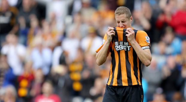 Hull captain Michael Dawson looks dejected after the final whistle