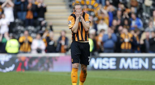 Michael Dawson looks dejected after Hull's relegation was confirmed on Sunday