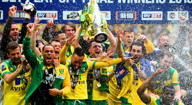 We are going up: Victorious captain Russell Martin celebrates with his Norwich City team-mates at Wembley