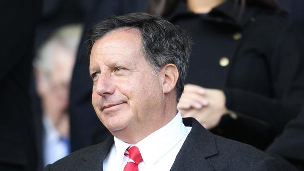 Liverpool chairman Tom Werner, pictured, will hold talks with Brendan Rodgers when he arrives on Merseyside