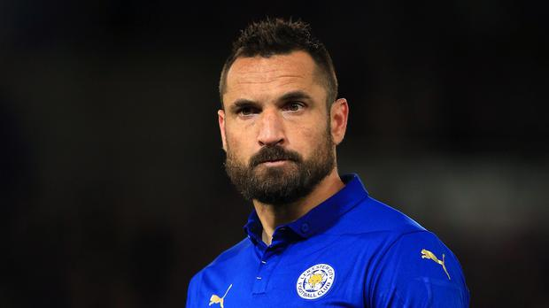 Poland defender Marcin Wasilewski says he has signed a new Leicester contract