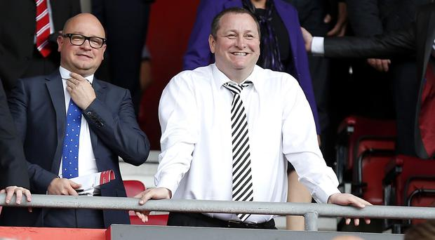 Mike Ashley, right, has tasked Lee Charnley, left, with finding Newcastle's next manager