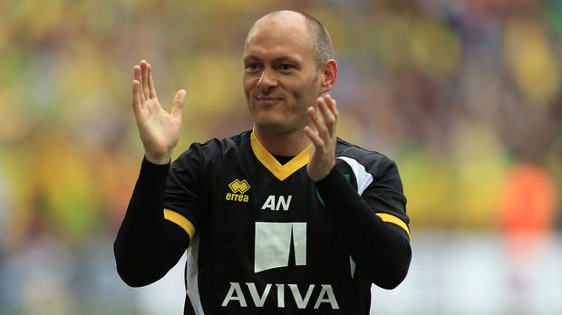 Norwich manager Alex Neil is celebrating a new contract