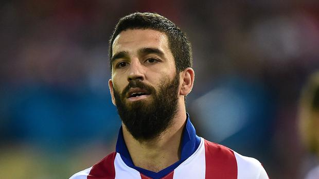 Atletico Madrid midfielder Arda Turan wants to play in the Premier League