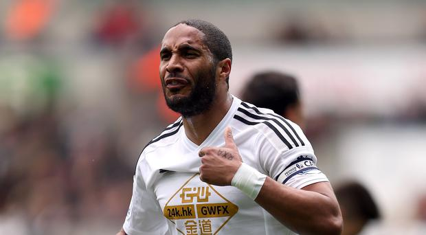 Swansea and Wales captain Ashley Williams has revealed how working with a psychologist has helped his leadership style