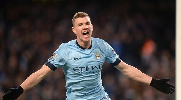 Edin Dzeko scored four goals in 23 Premier League appearances for Manchester City in the 2014-15 campaign.
