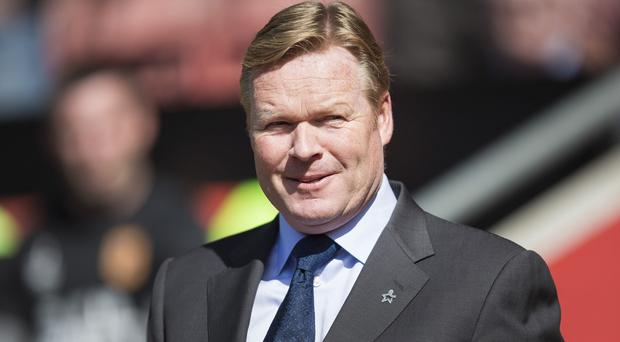 Ronald Koeman, pictured, has strengthened his Southampton defence with the capture of Cuco Martina