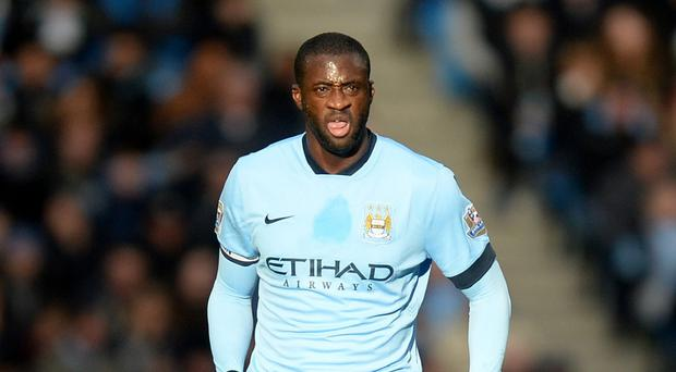 Manchester City midfielder Yaya Toure is targeting a return to the top