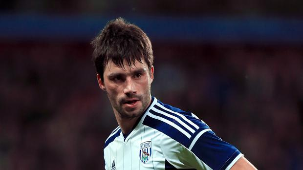 West Brom midfielder Claudio Yacob has signed a new two-year deal.