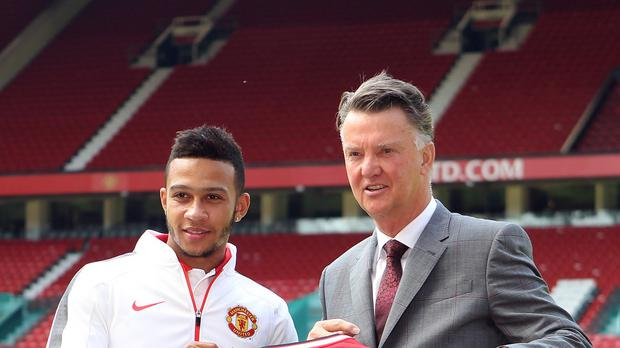 Louis van Gaal (right) signed Memphis Depay earlier this summer and could add more players