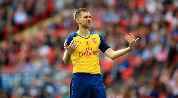 Defender Per Mertesacker has challenged Arsenal to raise their game again next season
