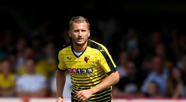 Watford's Almen Abdi has signed a new three-year contract with the club.