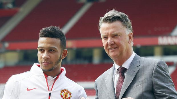 Memphis Depay (left) with Louis van Gaal at his unveiling at Old Trafford