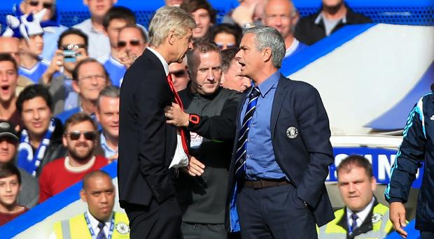 Jose Mourinho, right, believes Arsenal boss Arsene Wenger, left, has a side that could challenge for the title