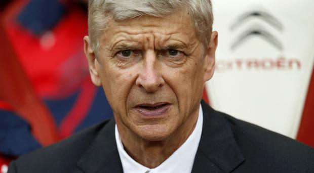 Arsene Wenger, pictured, has played down comments from Chelsea boss Jose Mourinho over Arsenal's transfer policy