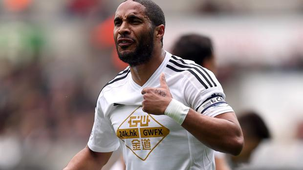 Swansea captain Ashley Williams is going nowhere this summer.