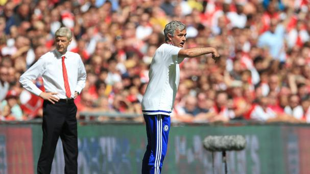Arsene Wenger, left, suggested a lack of respect was behind his decision to snub Jose Mourinho after the Community Shield.
