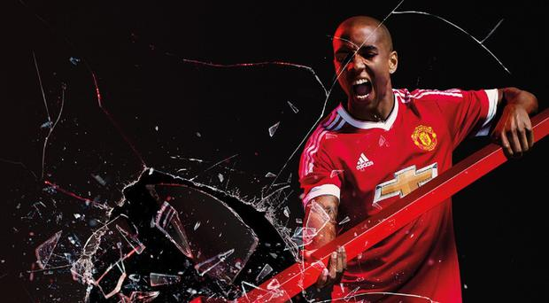 Ashley Young has signed a new three-year contract with Manchester United