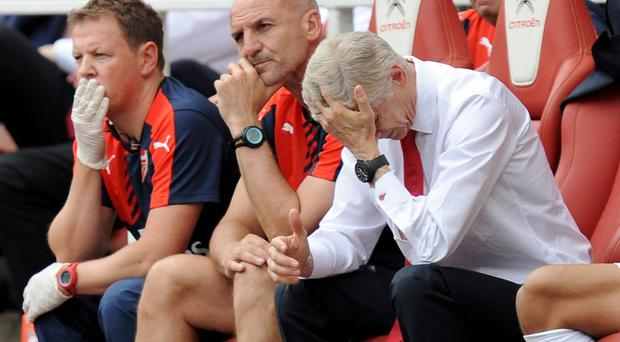 Arsene Wenger, right, during the Barclays Premier League match at the Emirates Stadium