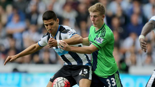 Aleksandar Mitrovic, left, was only booked for a wild challenge on Matt Targett, right