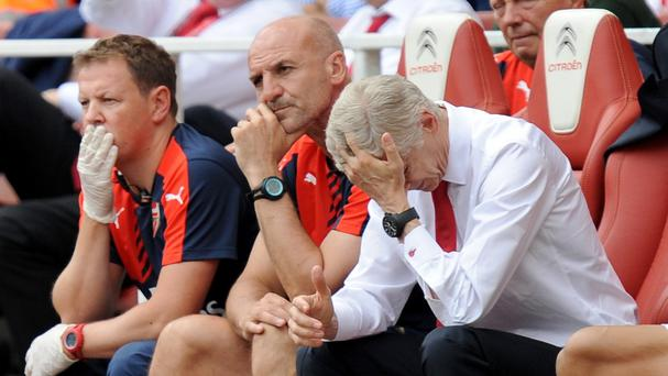Arsenal manager Arsene Wenger, right, was less than impressed by his team