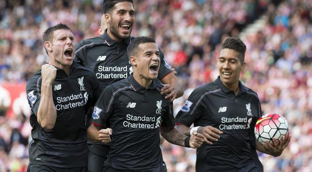 Philippe Coutinho, centre, scored an exceptional goal as Liverpool won 1-0 away at Stoke