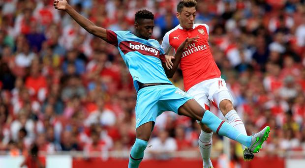 Reece Oxford, pictured left, made an assured league debut for West Ham on Sunday