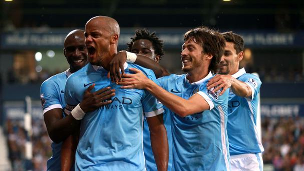 Manchester City's Vincent Kompany, second left, celebrates his third goal in their 3-0 win at West Brom