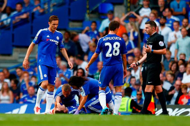 Painful reaction: Eden Hazard receives the treatment from Eva Carneiro which led to Jose Mourinho's public criticism