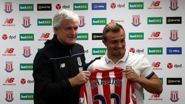 Xherdan Shaqiri, right, joined Stoke on Tuesday for a club-record £12million