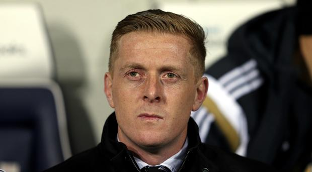 Swansea manager Garry Monk, pictured, is going up against Steve McClaren for the first time