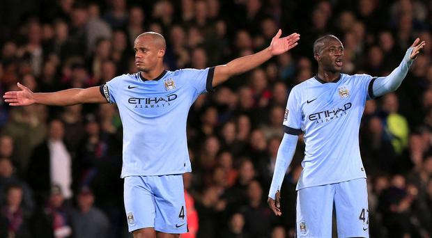 Manuel Pellegrini expects Vincent Kompany, left, and Yaya Toure, right, to come back strongly after last season's frustrations