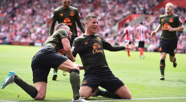 Ross Barkley, right, celebrates with team-mate Tom Cleverley after scoring Everton's third goal