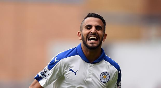 Riyad Mahrez celebrates scoring for Leicester in their win over West Ham