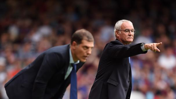 Leicester boss Claudio Ranieri (right) saw his side go top of the table with a win at West Ham.